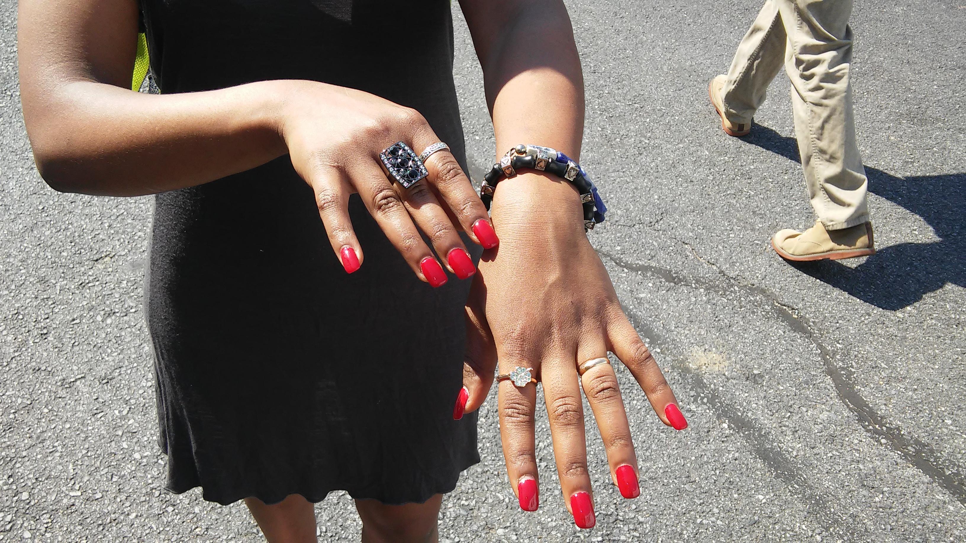 Arts Rave Sept. 2015 - Woman admires ring & Nikus bracelets