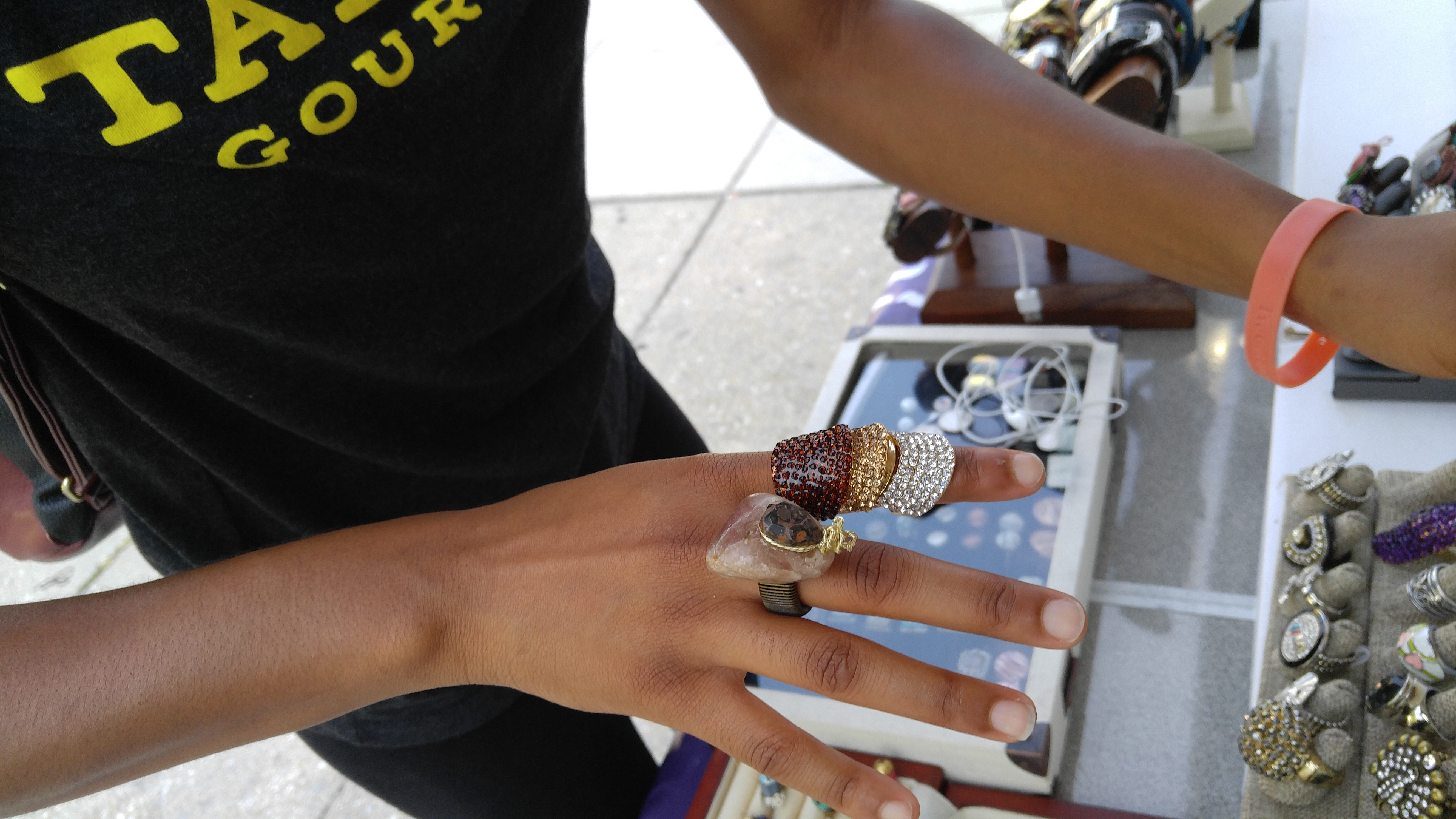 Customer trys on rings at Nikus Booth, Sept. 2016