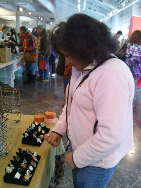 Visitor admiring ring at Ann Marie Sculpture Garden Valentine Makers Market