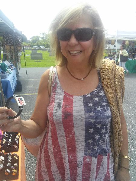 July 4th at St. Lukes Church Arts & Crafts, Customer admires bracelet