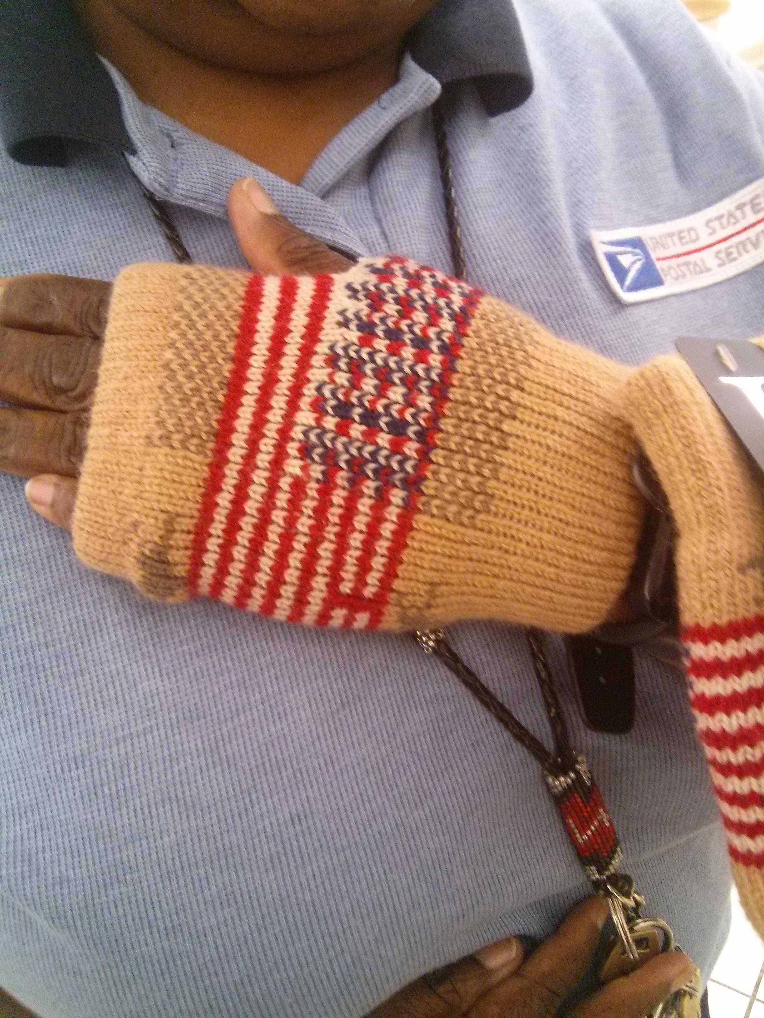 Customer tries on Fingerless Hand Warmer Gloves @ USDA