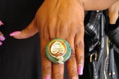 Customer wears Nikus ring with mosaic turquoise & heart finding, Adams Morgan Day