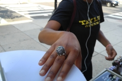 Customer admires Nikus rings, Sept. 2016