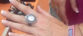 July 4th at St. Luke's church, guest admires watch ring